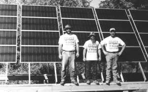 Denis Oliver, Dave Cain, and Roy Butler in front of 1280-watt solar array next to a home in Georgia. Four Winds designed and installed the system.