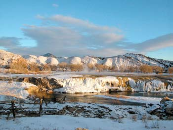 Hot Springs State Park, on the edge of Thermopolis, in winter. This shot shows the cooling ponds and the Rainbow Terrace, created from mineral deposits as the hot water falls into the Big Horn River. Locals say that winter is the best time for soaking or swimming in the hot spas in the park.