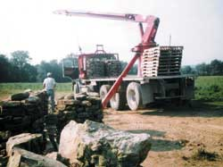 A customer loads out a truckload of palletized native stone.