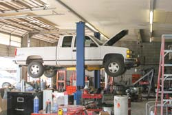 Though you will need the services of a professional shop at some point, hopefully by following this advice your ride can spend less time on the lift, like this truck, and more time on the road.(Photo by Sean R. Kienle)
