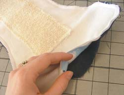 Sew around the edge of the diaper, leaving a 3-4 inch gap in the front for turning