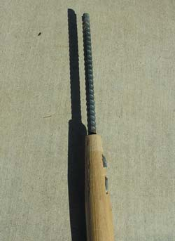 A rake handle with recycled rebar inserted makes a stout walking stick that can also be used for self-defense.