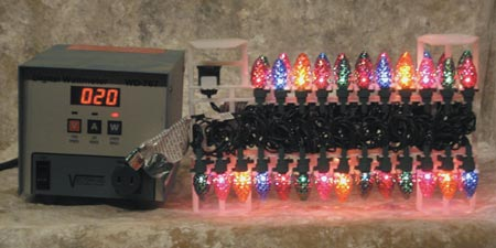 50-count string of standard Christmas tree lights drawing 20 watts of power