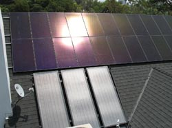 Drain-back solar hot water system with solar photovoltaic electric system