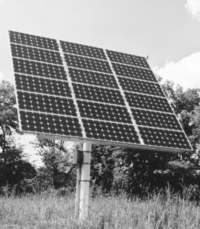 Pole-mounted solar PV array on motorized tracking mount
