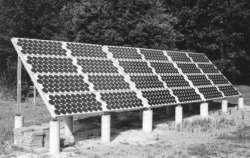 Ground-mounted solar PV array attached to aluminum frame and concrete piers