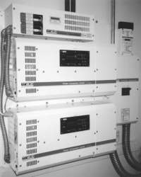 Dual 4 kW Trace sine wave inverters to provide 120 and 240-volt AC power from a 48-volt DC battery bank