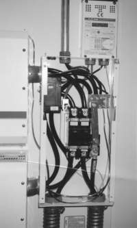 DC circuit breaker box (cover removed) showing much larger components and wire required to protect inverter (on left) and charge controller (on top)