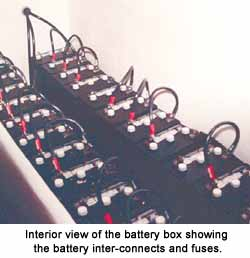 Interior view of the battery box showing the battery inter-connects and fuses.