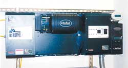 Outback 2 kW sine wave inverter including optional AC (left) and DC (right) power centers
