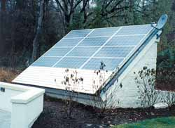 Kyocera solar modules mounted on outbuilding roof.