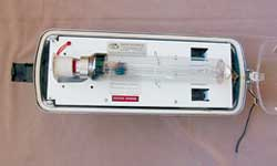 Figure 4. Low-pressure sodium fixture with lens removed. Note timer program control dip switches.