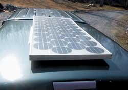 100 watt solar module mounted on roof of truck bed cap