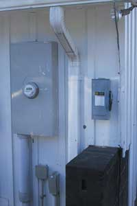 Photo 5: Utility required emergency solar disconnect located next to utility meter