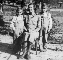 Mrs. Augustus Yeager and sons August Garrett and James Harrel. In order to keep shoes nice for church and special occasions, children went barefoot during warm weather. Many little boys and grown men, too, wore overalls. Clothing was worn until it had to be patched and then worn again.