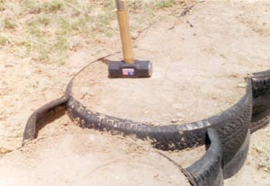 Fig. 2 - Dirt is compacted in the trimmed tires as well as inside the pieces used to fill the 'valleys.'