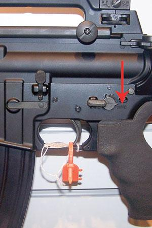 "Arrow shows visually tiny but operationally huge difference between one-shot-at-a-time AR15, and this M16/M4 set on full ""AUTO,"" i.e., machine-gun mode. AR15s look the same but don't work the same."