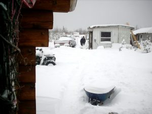 David shoveling a trail to the truck and generator shed