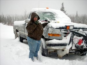 Me shoveling off the truck so David can go plowing