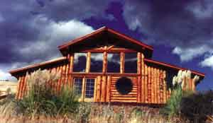 The completed second log home.