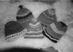 Some of Margaret's ski caps that she made out of un-dyed yarn