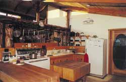 My kitchen with my three-foot-square butcher block and pot racks.