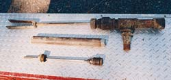 From top to bottom: Pump-rod assembly, cylinder, and plunger with leathers