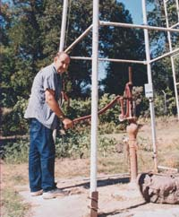 John has a hand pump on one of his wells.