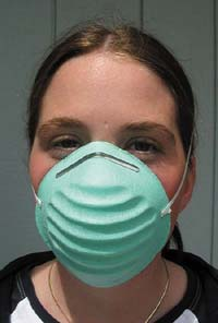 Surgical masks or other masks that cover the nose and mouth are effective in blocking the droplets that contain the SARS virus. Healthcare workers and others in very close contact with patients having any infectious disease use special surgical masks, called N-95 respirators, which have been certified to block out infectious microorganisms.