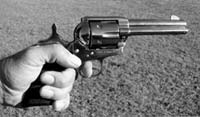 This is the intuitive way to hold a single action, with all three grasping fingers in front of the grip. It softens recoil but slows rate of fire because...