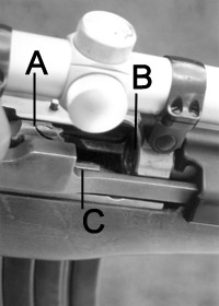 With bolt (A) partially retracted on this Ruger Ranch Rifle, empty chamber (B) and loaded magazine (C) are both visible.