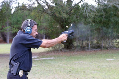 "With a Guncrafters caliber .50 GI firing in each hand, author sends 600 grains of lead downrange at once. Not terribly practical, but big time ""gun fun."""