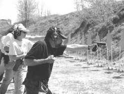 Ayoob shoots a qualification course with Wolf Ears. Though barely visible, even in daytime, the SureFire light clipped to front of his belt in a carrier he designed.