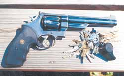 Good locks and responsibly kept firearms are two pieces of the burglar protection jigsaw puzzle. The .45 caliber revolver, an intimidating home defense weapon, is Smith & Wesson's classic 1955 Target Model.