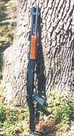 Author's rural 'car gun' is this Remington 870 12-gauge pump shotgun. It features rifle sights, extended magazine....