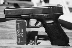 America's most popular police service pistol today is this Glock 22. It holds 16 rounds of .40 S&W ammo like this Black Hills EXP, which delivers 485 foot-pounds of energy per shot.