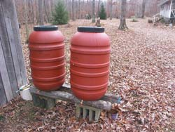 Plastic barrels with spigots. We never needed this water, but I'm glad we got the barrels and set them up for water. Plans are to make a water tower and use them for drip irrigation.