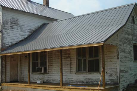 The first step in rehabilitating this old house was to install a new steel roof. A solid roof protects all the other work happening inside.
