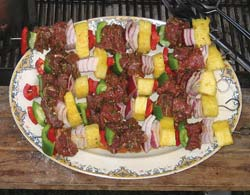 There is a place for lamb in a heart healthy kitchen. These tasty lamb kabobs are made with American lamb with all the fat removed. You can see how big the meat and vegetables should be cut to fit perfectly on the skewers.
