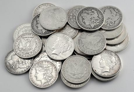 "Morgan and Peace silver dollars. These may not be your best buy unless you can get them at a low premium. The author bought these ""clunkers"" at a reasonable premium over spot."