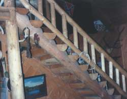 This is the half-log stairway I built in our last log home. It took two days, and if I can build it, you can build it.