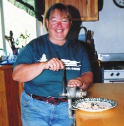 Author grinding shelled acorns in a hand grinder