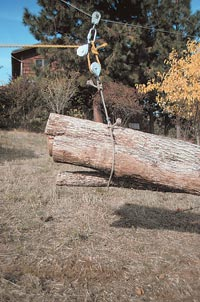 Figure C: During skyline yarding operations, when ground block, with choker wrapped around several poles, is pulled close to hanging block and carabiner of the slack-pulling skyline, the skyline carriage hung on the cable is being speedily pulled toward the yarder with several poles in tow