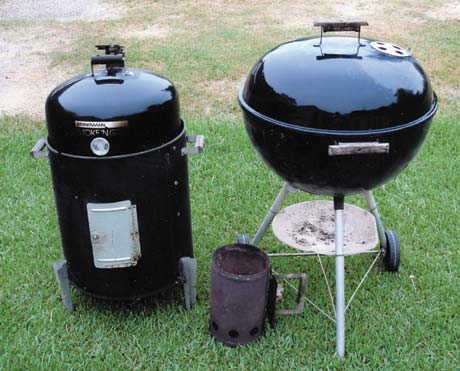 "The traditional bullet type water smoker (left) has two levels for cooking. A kettle grill can be used for ""grillinsmokin'."" A charcoal chimney starter allows you to pre-burn the charcoal."