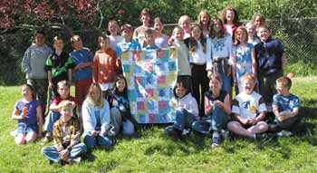 Mrs. Margolis' 4th grade class with the completed quilt