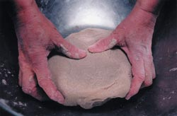 Continue working the flour until a smooth dough is formed.