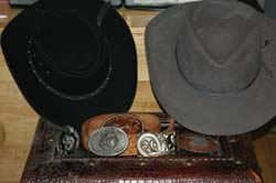 Western hats and belt buckles are great sellers if you have a stash kicking about that nobody in your house wears anymore. These fine ones here have tons of good wear left in them.