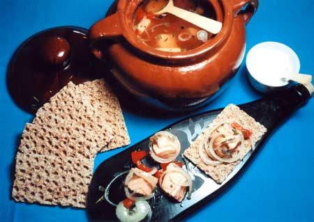 Salmon pickles make a tasty appetizer with crisp rye crackers and sour cream.
