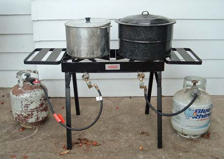 A two-burner outdoor propane stove is ideal for a canning party. My husband retrofitted this one to hook up one propane tank for each burner.