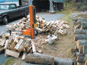 Days work half done. The firewood goes to the wood shed, the shakes go to the pile, the splitter goes in the shed, the tools go back to the shop and the scrap goes into 'fire bags.' About a cord per day can be processed by one middle-aged person in reasonable health.
